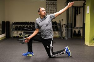 Todd demonstrating walking lunge with twist
