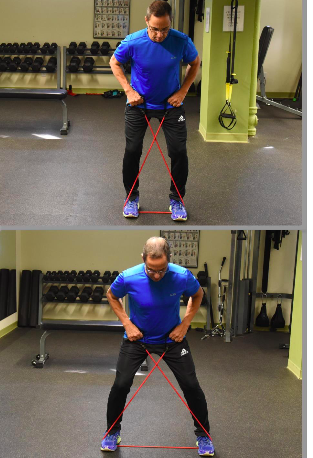 Todd demonstrating lateral walk with resistance band