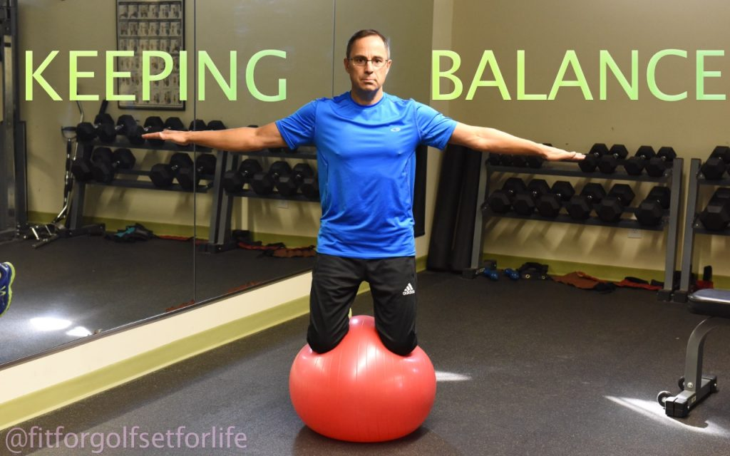 Balance Header, Todd kneeling on balance ball